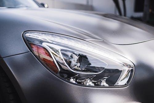 Silver Car With Broken Mirror