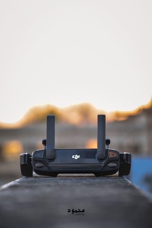 Foto profissional grátis de Adobe Photoshop, câmera drone, controlador de drone