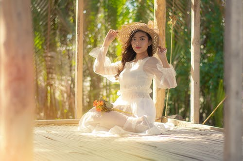 Woman Wearing White Dress and Sun Hat