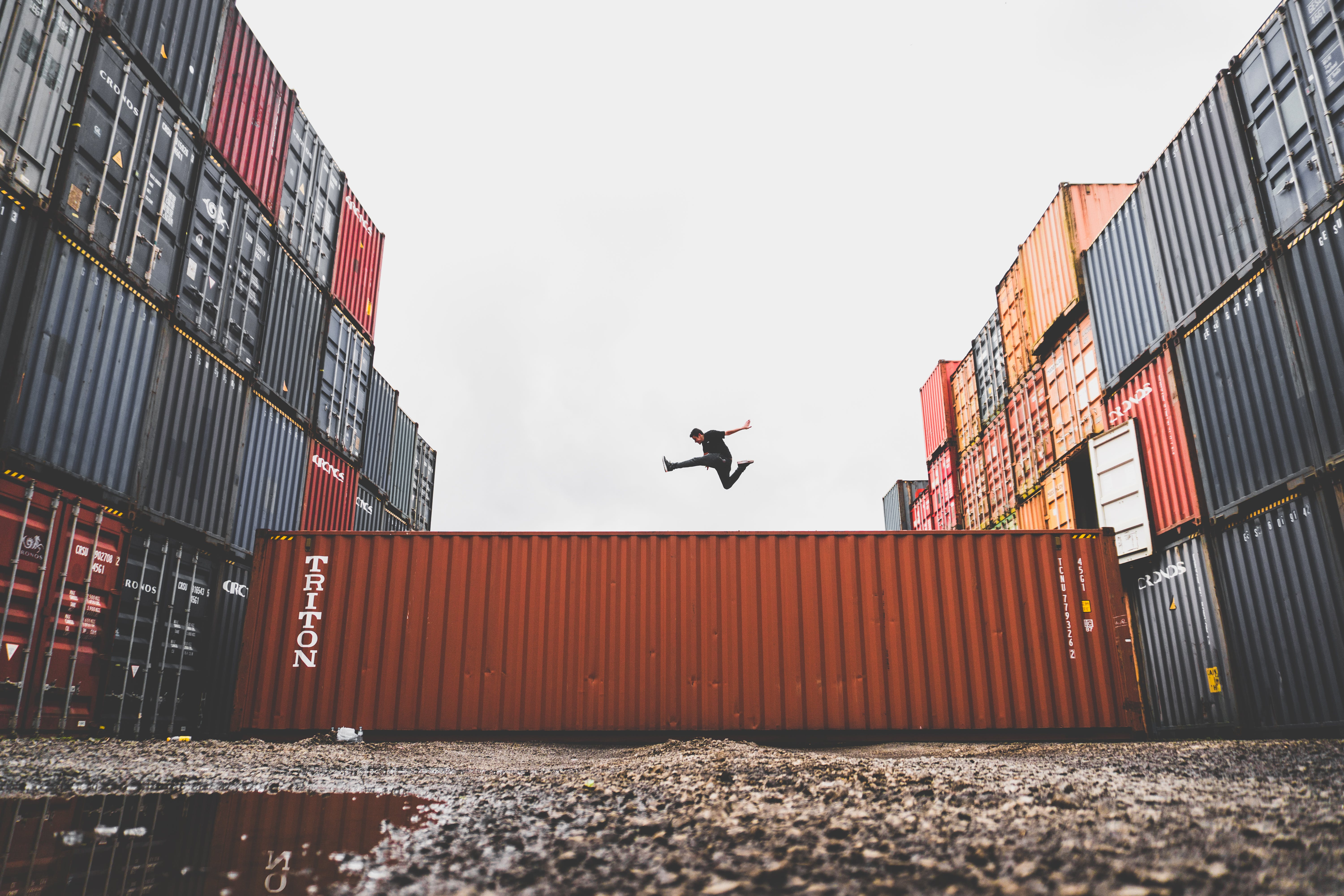 Man Jumping on Intermodal Container