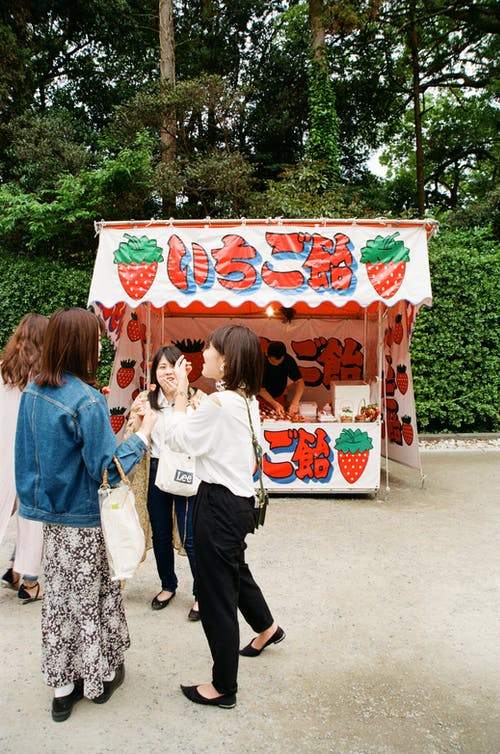 Group of Women Eating Strawberries and Talking