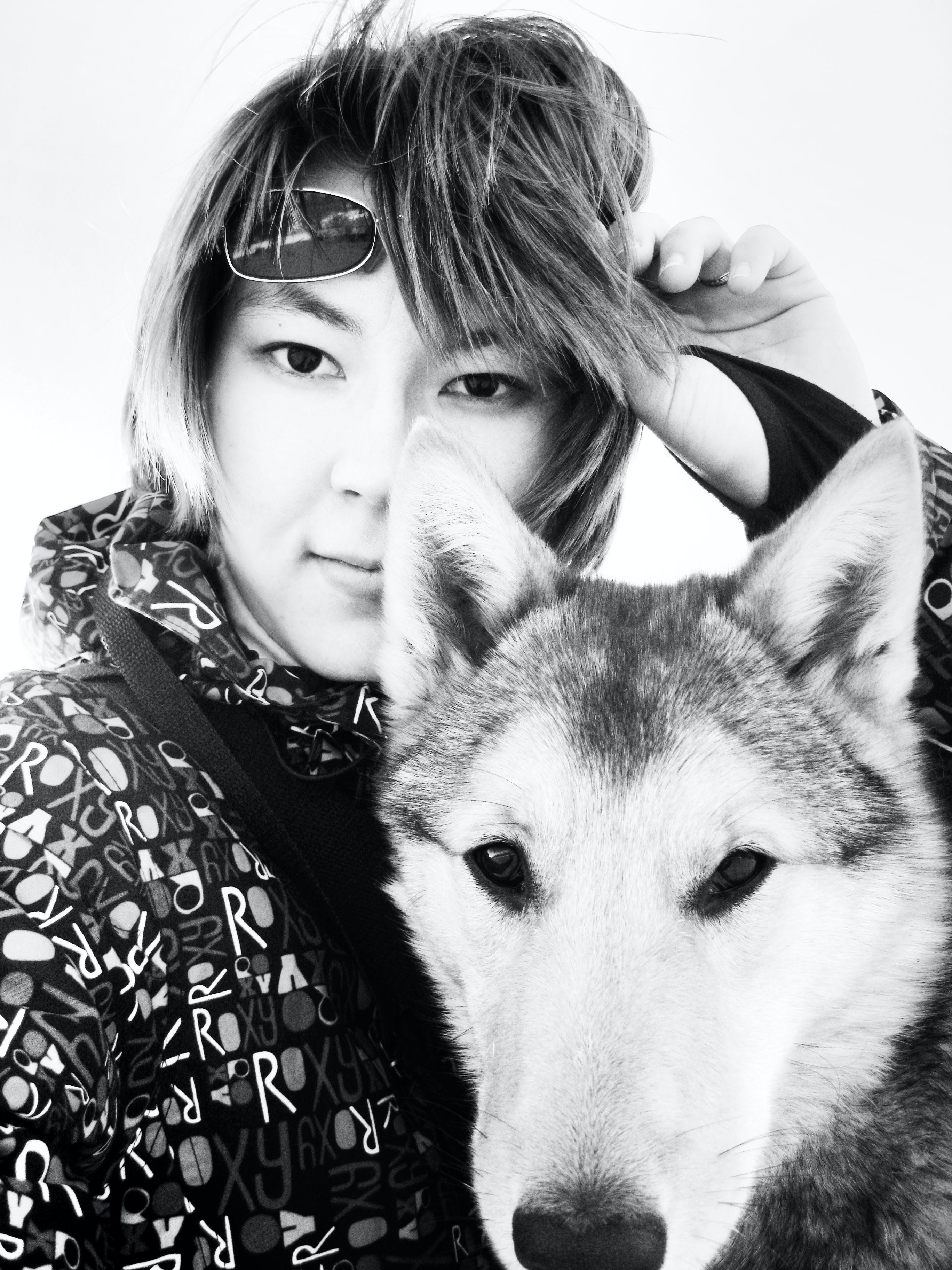 Free stock photo of Asian, black and white, dog, girl