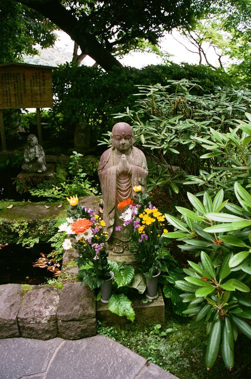 Statue of a Buddha with Flowers