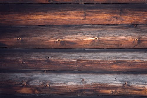 Top view element of natural wooden wall surface with brown horizontal timber panels as abstract background