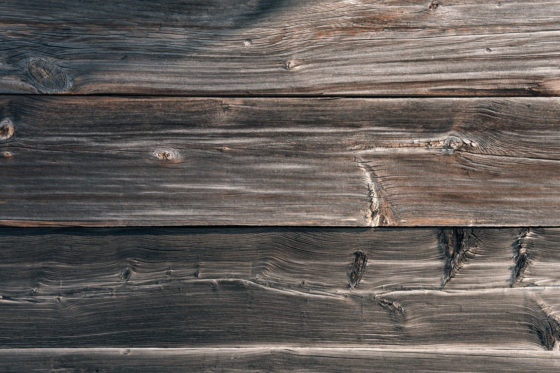 From above texture of aged shabby wooden table made of natural lumber panels as abstract background