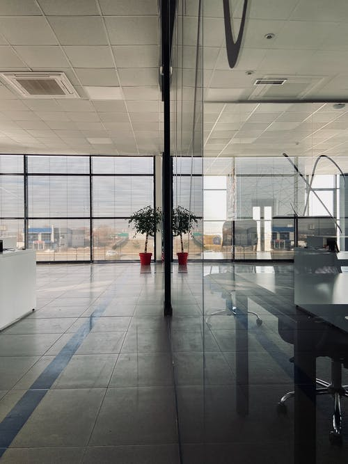 Stylish interior of modern office with glass walls