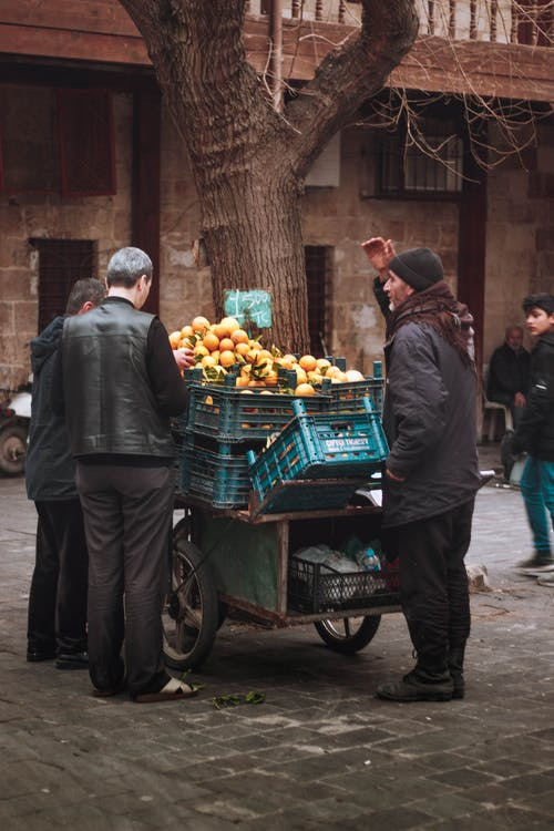 Old man selling fruits on street