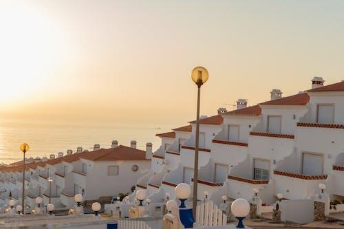 Free stock photo of beach sunset, houses, sun