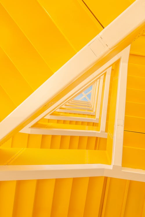 Stylish yellow stairway in creative building