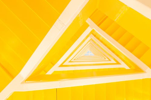 Yellow geometric staircase in contemporary apartment