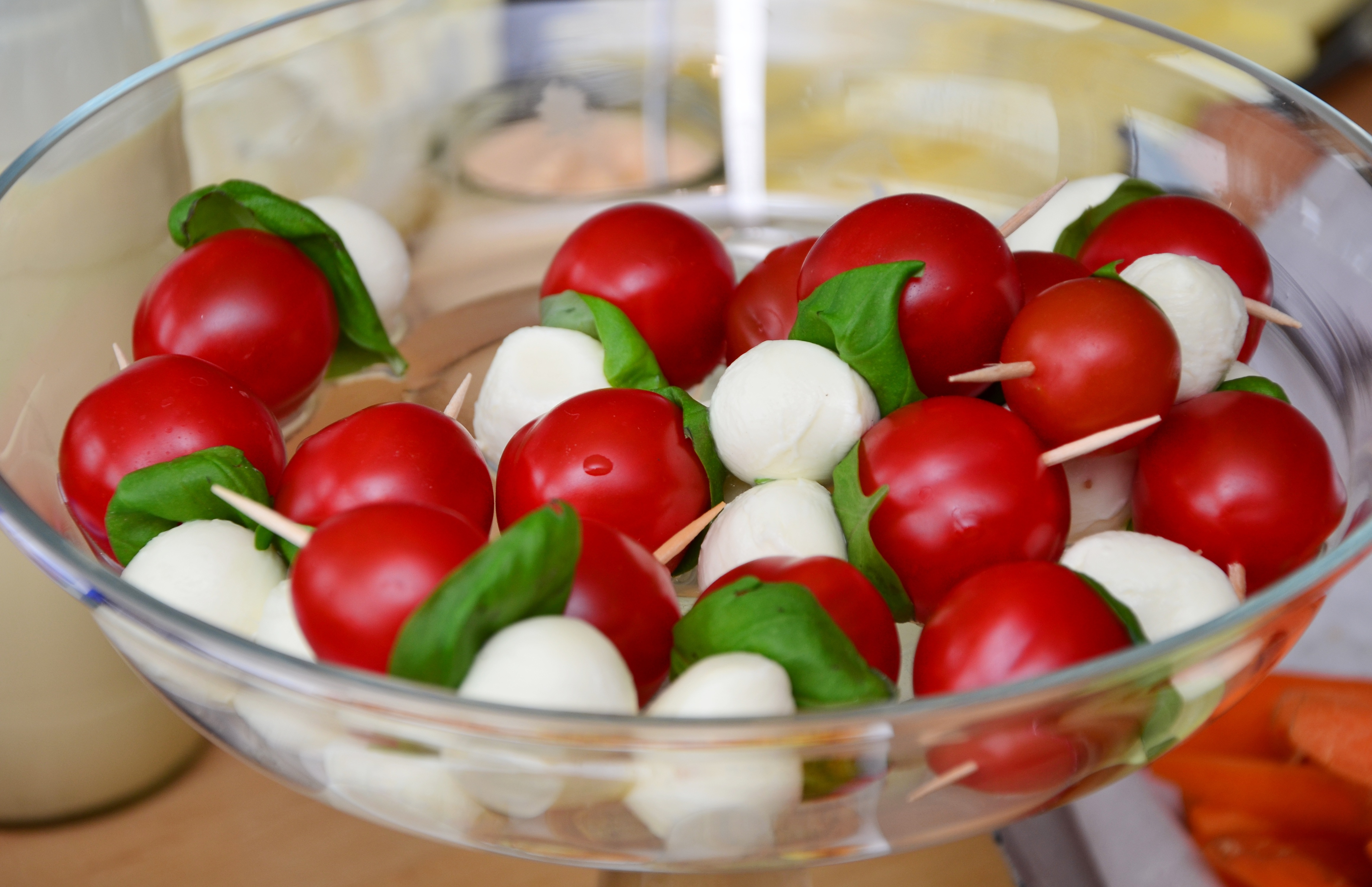 Red Round Fruit Served on Clear Glass Bowl