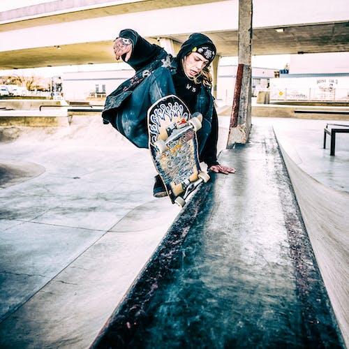 Photo of Person Skateboarding in Skatepark