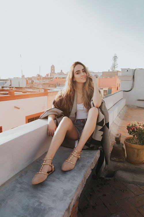 Woman Sitting on Concrete Bench