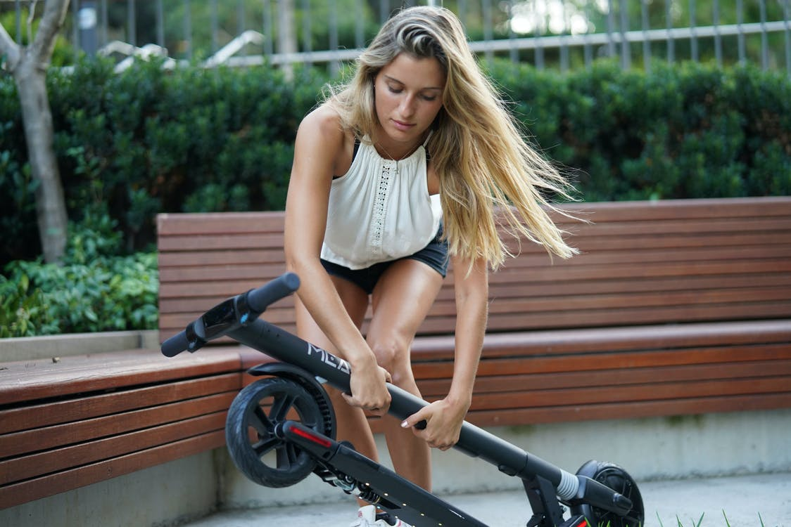 Free stock photo of electric scooter, folding electric scooter, woman