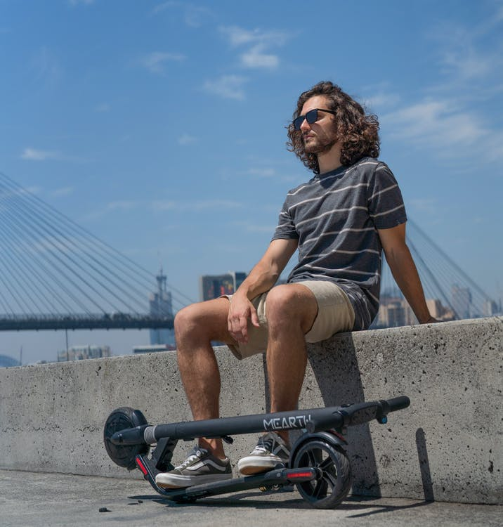 Free stock photo of bridge, electric scooter, man
