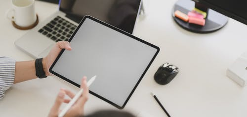 Photo of Person Holding Tablet Computer