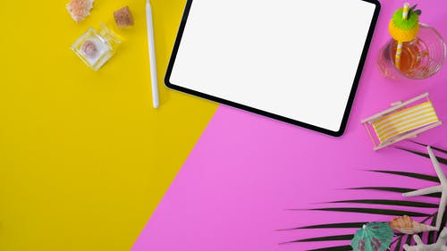 White Paper on Yellow Pink and Green Textile