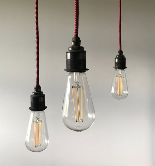 Light bulbs hanging on ceiling in light room