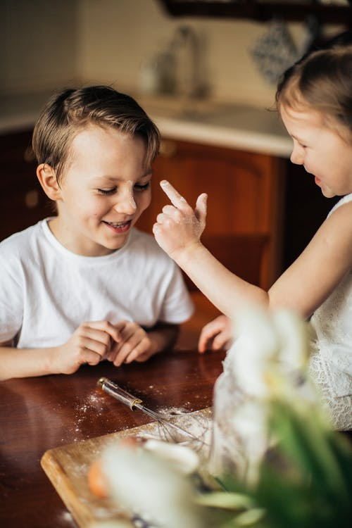 Photo of Kids Playing With Flour