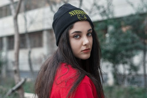 Shallow Focus Photo of Woman Wearing Black Beanie