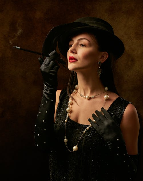 Woman Wearing Black Sleeveless Top and Black Hat