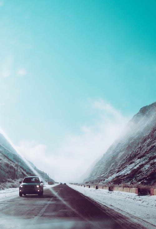 Free stock photo of cars, mountains, road, smoke