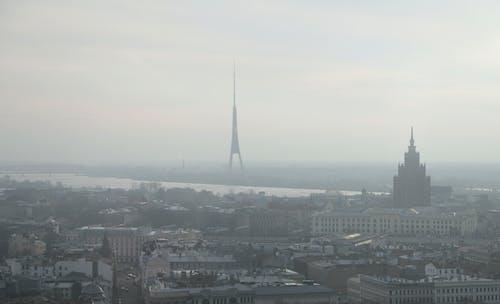 Gloomy Riga cityscape on foggy day