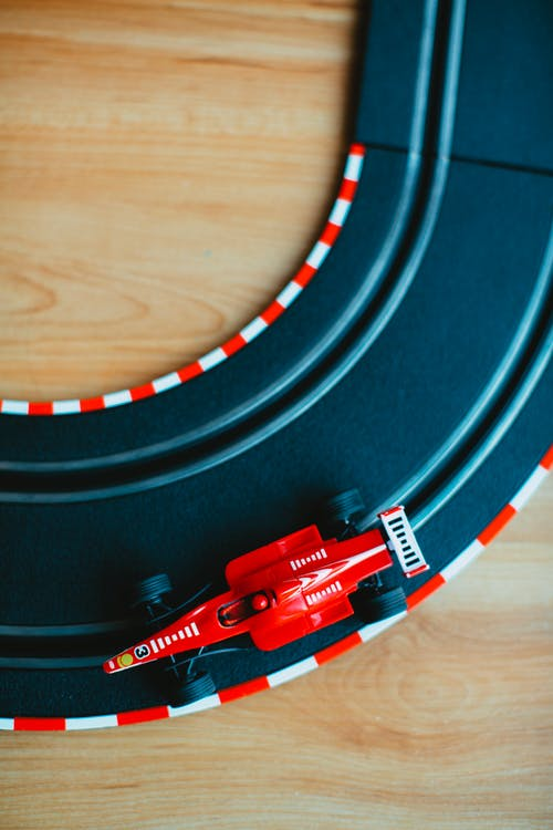 Top View Photo of Toy Car in Race Track