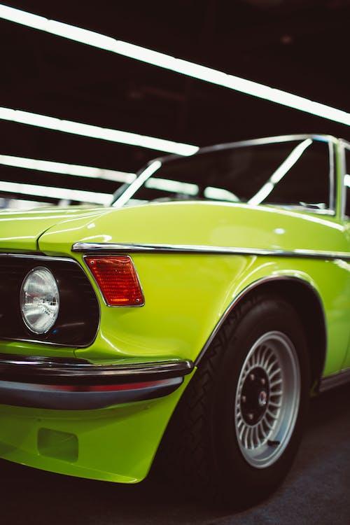 Retro car in bright neon color