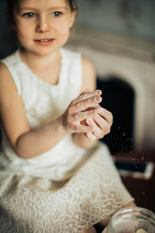 Girl Playing With Flour