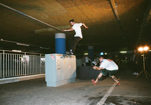 Photographer Taking a Picture of a Man on a Skateboard Grinding
