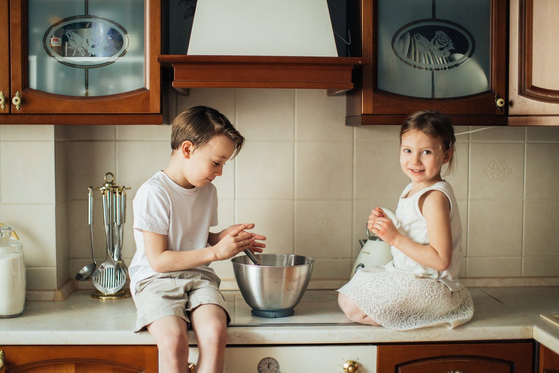 Photo of Kids Playing on Kitchen Counter Top
