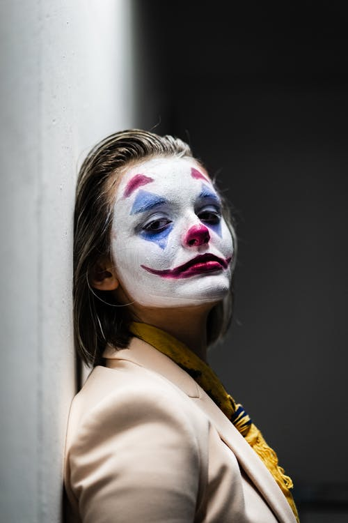 Woman With White and Red Face Paint
