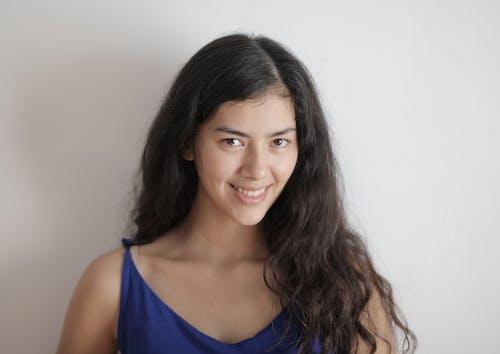 Cheerful young woman smiling at camera