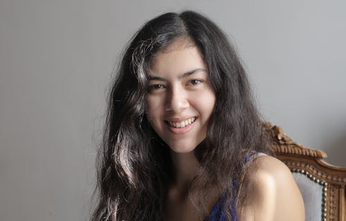 Young ethnic woman smiling at camera