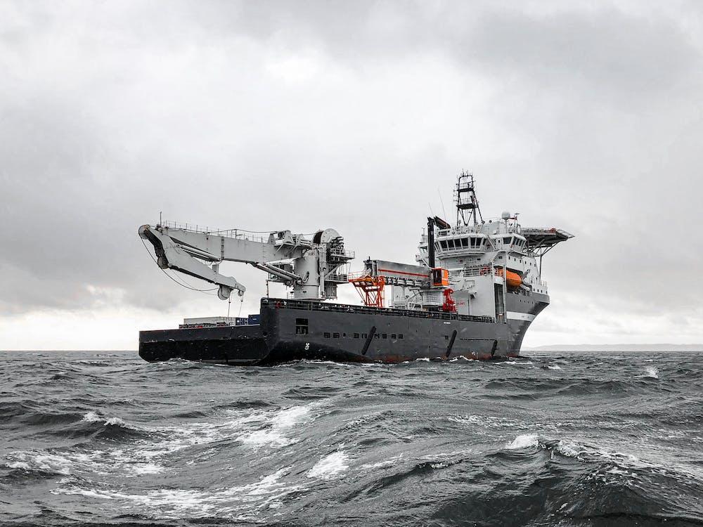 White Ship on Sea Under White Sky