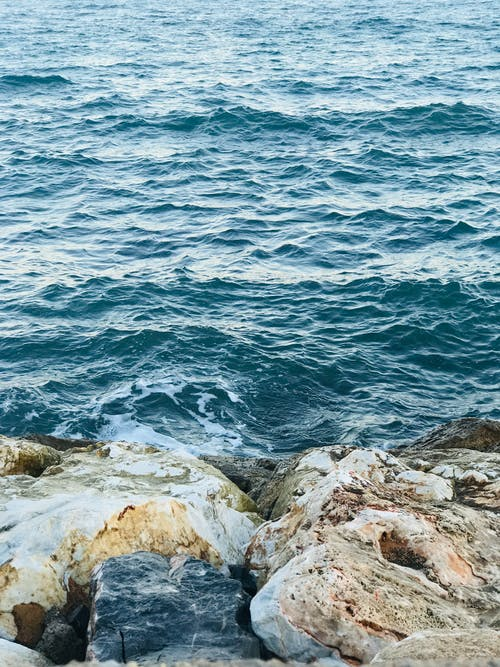 Rocky coast washed with clear water