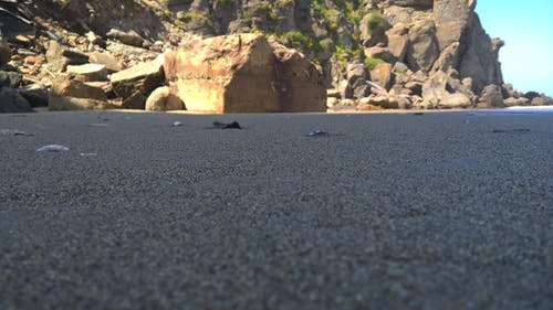 Gratis arkivbilde med rock, sand, sjø