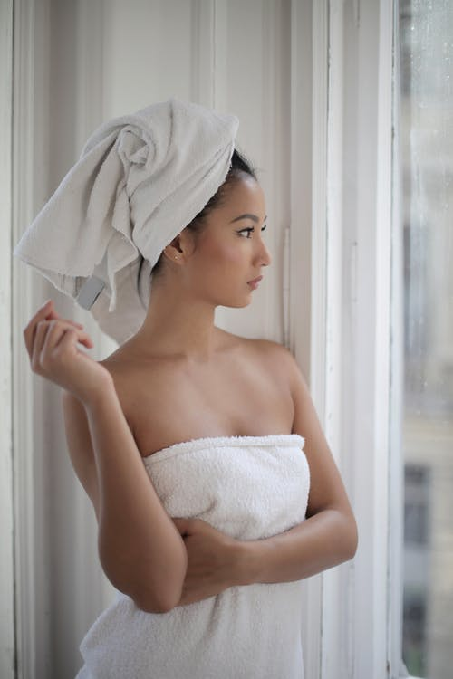 Topless Woman Covered With White Towels