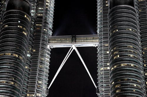 Twin high rise towers at night