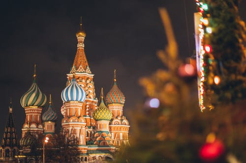 Famous Cathedral of Vasily Blessed on Red Square against dark cloudy evening sky during Christmas holidays in Russian Federation