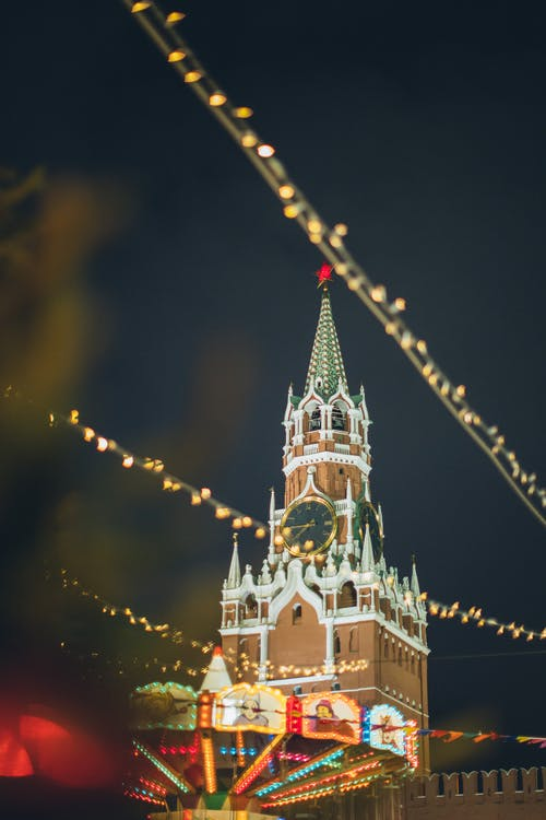 New Year fairground against Kremlin on Red Square at holiday night