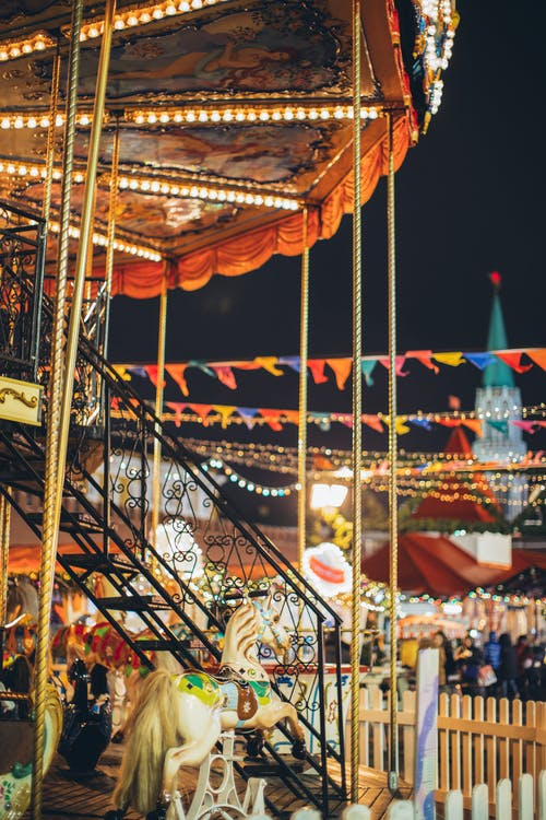 Colorful carousel in amusement park at night