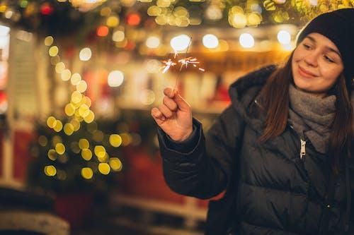 Woman in Black Jacket Holding Lighted Sparkler