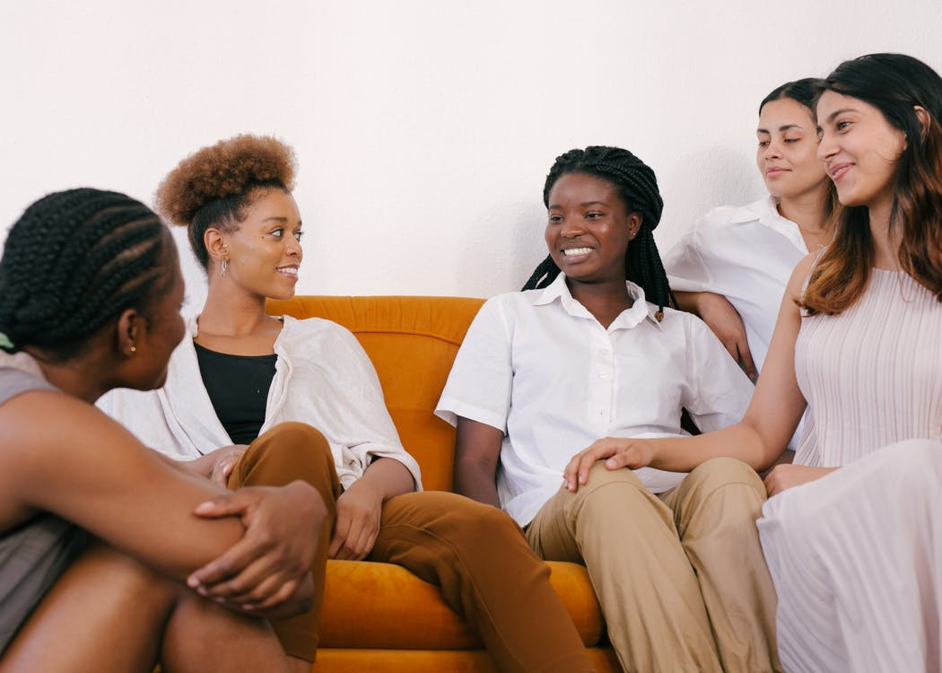 Photo of Women Sitting While Talking