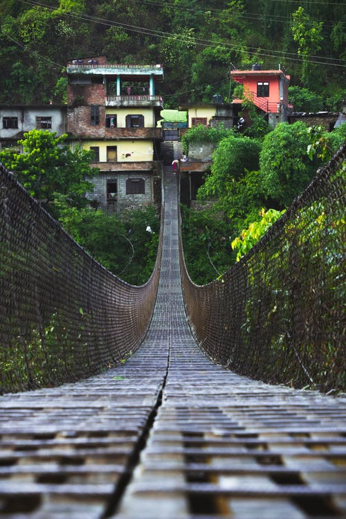 Brown Wooden Suspension Bridge over River