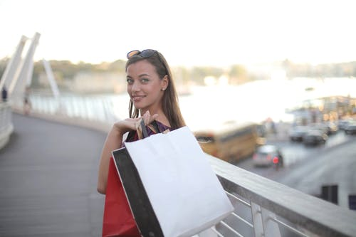 Shallow Focus Photo of Woman Carrying Shopping Bags
