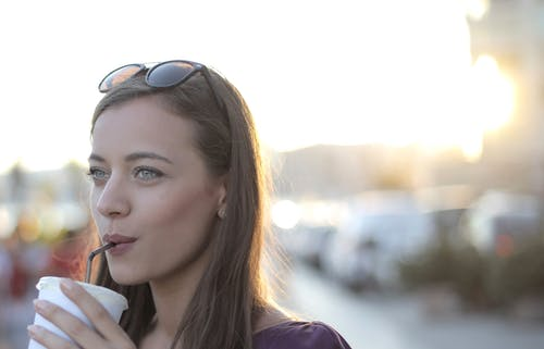 Shallow Focus Photo of Woman Drinking