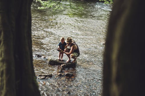 Photo of Man and Child on Rock