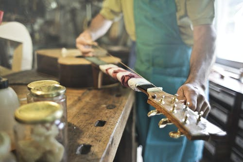Photo of Person Making a String Instrument